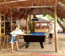 A game of pool on the beach by Lantaresort.com